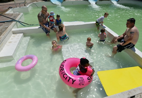 Participants from the 50th Space Wing Chapel-sponsored family retreat relax in the swimming pool Saturday, Aug. 15, 2015, at the Horn Creek Christian Camp and Conference Grounds in Westcliffe, Colorado. Twenty Schriever Air Force Base families travelled more than 100 miles to spend 48 hours together with no Wi-Fi, television or other outside distractions in order to focus on family bonding and fun. (U.S. Air Force photo/Staff Sgt. Debbie Lockhart)