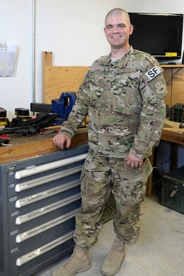 Tech. Sgt. Kevin Beers, 446th Security Forces Squadron combat arms instructor, out of Joint Base Lewis-McChord, Wash., searches for weapons parts for an M-4 rifle Aug. 10, 2015, at Bagram Air Field, Afghanistan. Beers is deployed as the CATM instructor for the 455th Expeditionary Security Forces Squadron. As Bagram's only weapons repairman, he's responsible for repairing weapons for the security forces squadron, logistics readiness squadron, Marines and all other units out of Bagram. (U.S. Air Force photo by Senior Airman Cierra Presentado)