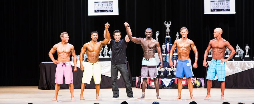Senior Airman Miguel Amador, 5th Medical Group medical information service technician, receives second place in the Gopher State bodybuilding competition in Minneapolis, MN, April 18, 2015. Amador has begun training for his next bodybuilding competition, which is in October. (Courtesy photo)