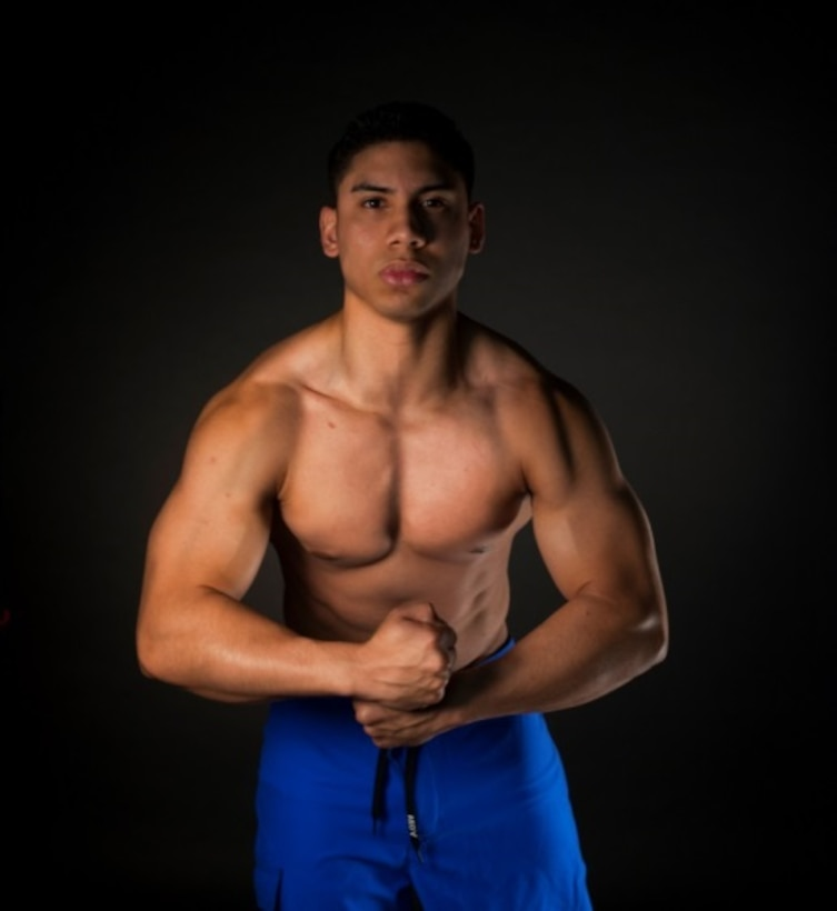 Senior Airman Miguel Amador, 5th Medical Group medical information service technician, flexes his muscles at Minot Air Force Base, N.D., Aug. 11, 2015. Amador has begun training for his next bodybuilding competition, which begins in October. (U.S. Air Force photo/Airman 1st Class Christian Sullivan)