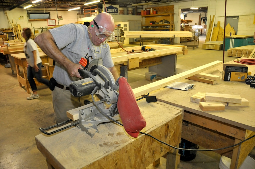 KNOXVILLE, Tenn. - Master Sgt. Don Pierson, a manager assigned to the I.G. Brown Training and Education Center on McGhee Tyson Air National Guard Base, cuts lumber inside a wood shop August 18, 2015, to fabricate window and door frames. About a dozen military volunteers took part in the two-day Habitat for Humanity project in North Knoxville. (U.S. Air National Guard photo by Master Mike R. Smith/Released)
