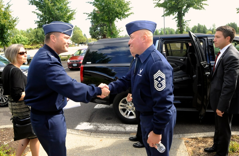 Air Force Chief Master Sgt. Mitchell O. Brush, Senior enlisted advisor for the National Guard Bureau, right, shakes hands with Brig. Gen. Michael Stencel, the interim Adjutant General for Oregon, left, after a town hall event, Aug. 15, 2015, Portland Air National Guard Base, Ore. (U.S. Air National Guard photo by Tech. Sgt. John Hughel, 142nd Fighter Wing Public Affairs/Released)
