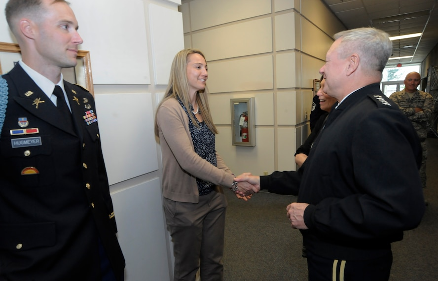 Army Gen. Frank J. Grass, Director of the National Guard Bureau, greets Ms. Amy Conroy, 142nd Fighter Wing Family Programs Director, following a town hall event, Portland Air National Guard Base, Ore., Aug. 15, 2015. (U.S. Air National Guard photo by Tech. Sgt. John Hughel, 142nd Fighter Wing Public Affairs/Released)