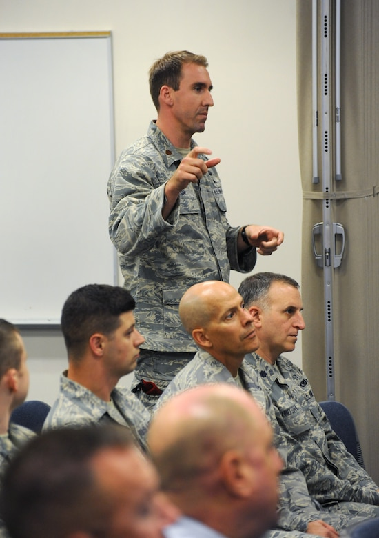 Air Force Maj. Tarek Awada, 125th Special Tactics Squadron commander, asks a question of Army Gen. Frank J. Grass, director of the National Guard, during a town hall event, Aug. 15, 2015, Portland Air National Guard Base, Ore. (U.S. Air National Guard photo by Tech. Sgt. John Hughel, 142nd Fighter Wing Public Affairs/Released)