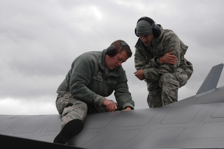 U.S. Air Force Tech. Sgt. Sterling Hartwick and Staff Sgt. Chad Rochwite, both from the148th Fighter Wing, Duluth, Minn., perform repairs to the air refueling door on an F-16, Aug. 10, 2015, while participating in RED FLAG-Alaska 15-3 at Eielson Air Force Base, Alaska.  RF-A is a Pacific Air Forces commander-directed field training exercise for U.S. and partner nation forces, providing combined offensive counter-air, interdiction, close air support and large force employment training in a simulated combat environment.  (U.S. Air Force photo by Master Sgt. Ralph Kapustka/Released)