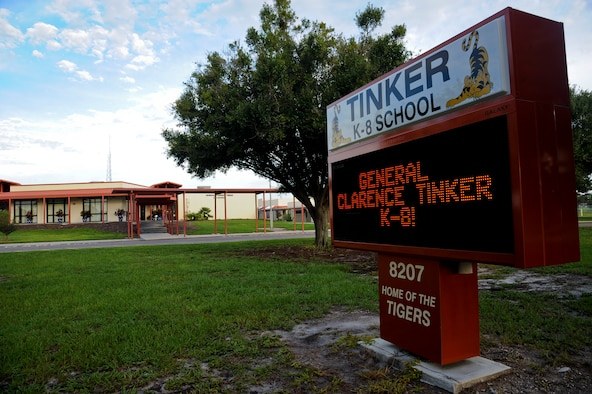 The marquee in front of General Clarence Tinker K-8 School displays the new grade range at MacDill Air Force Base, Fla., Aug. 14, 2015. Student registration hours are Monday through Thursday from 8:30-11:30 a.m. and 12:30-3:30 p.m. (U.S. Air Force photo by Airman 1st Class Danielle Quilla/Released)