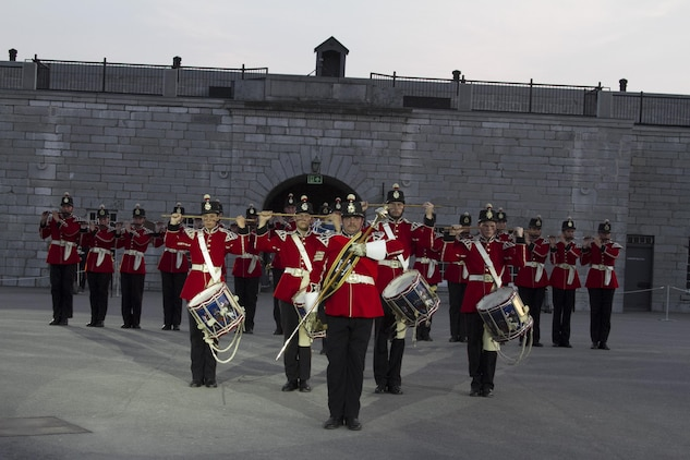 The Drums of the Fort Henry Guard performs during a joint ceremony with the Battle Color Detachment from Marine Barracks Washington, D.C., at Kingston, Ontario, Canada, Aug. 17, 2015. The relationship between the Marines and Fort Henry goes back 61 years to 1954 when the Marines first visited the Fort. This visit marked the anniversary of the Ogdensburg Agreement, which was signed by President Roosevelt and Prime minister King to bind the two nations in the joint defense of North America. Since that time, the two units have paraded together countless times both at the Fort and at Marine Barracks Washington, D.C. (U.S. Marine Corps photo by Cpl. Skye Davis/Released)