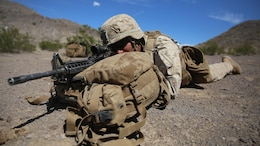 A Marine with 1st Battalion, 3rd Marine Regiment sights in on a target in a preparatory exercise for Large Scale Exercise 15 at Marine Corps Air Ground Combat Center Twentynine Palms, California, Aug. 11, 2015. LSE-15 is a combined U.S. Marine Corps, Canadian Band British Exercise conducted at the brigade level, designed to enable live, virtual and constructive training for participating forces.