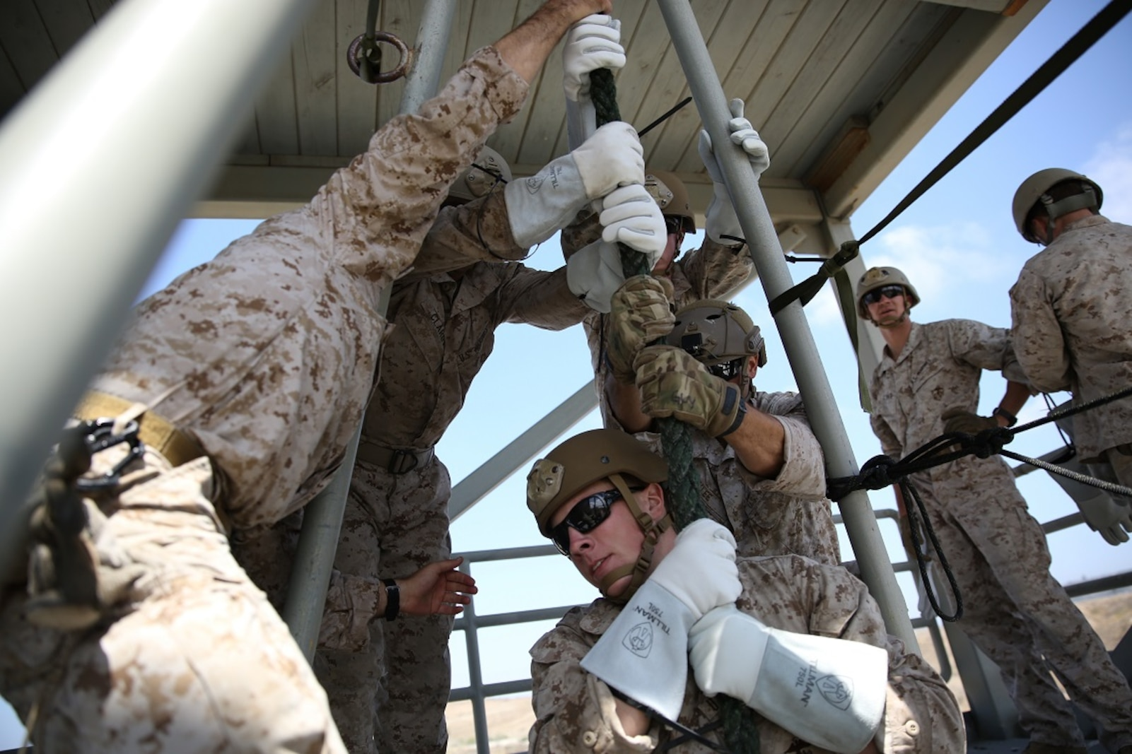 Marines assigned to Company A, 1st Reconnaissance Battalion, 1st Marine Division, prepare to fast-rope as a fire team aboard Marine Corps Base Camp Pendleton, Calif., Aug. 17, 2015. The Marines practiced fast-roping as a team to gain proficiency in order to effectively insert from a helicopter.