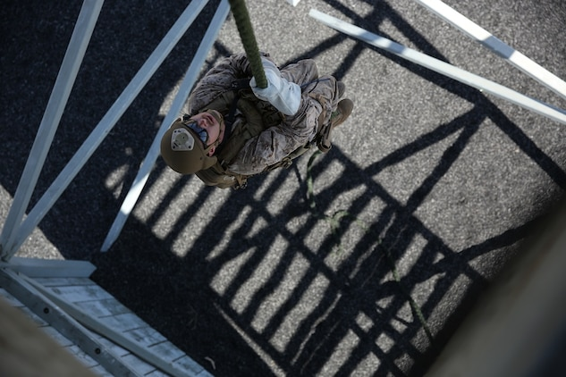 A Marine assigned to Company A, 1st Reconnaissance Battalion, 1st Marine Division, performs a lockout during Helicopter Rope Suspension Techniques training aboard Marine Corps Base Camp Pendleton, Calif., Aug. 17, 2015.  Practicing the lockout technique allows the Marines to stop on the rope rapidly in order to avoid landing in a potentially dangerous area.