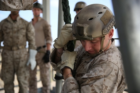 A Marine assigned to Company A, 1st Reconnaissance Battalion, 1st Marine Division, fast-ropes out of a tower as part of Helicopter Rope Suspension Techniques training to prepare for quick insertion missions out of helicopters aboard Marine Corps Base Camp Pendleton, Calif., Aug. 17, 2015. Fast-roping is the most commonly used insertion tactic for Reconnaissance Marines during training or real-life missions.