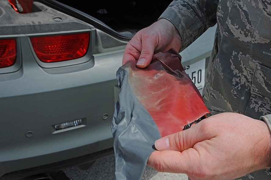 U.S. Air Force Tech. Sgt. Stephen Strong, 315th Training Squadron instructor, displays what the paint on his car looks like after being peeled off at Goodfellow Air Force Base, Aug. 18, 2015. Strong designs his own car by spraying on a type of paint that can peel off if he wishes to start over again. (U.S. Air Force photo by Airman Caelynn Ferguson/Released)