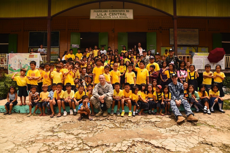 Medical professionals from the U.S. Air Force, Armed Forces of the Philippines and the Royal Australian Air Force traveled to Paaralang Elementary school to provide students information about oral heath, general hygiene and rabies prevention during Pacific Angel in Lila, Philippines, Aug. 17, 2015. Pacific Angel is a multilateral humanitarian assistance civil military operation, which improves military-to-military partnerships in the Pacific while also providing medical health outreach, civic engineering projects and subject matter exchanges among partner forces. (U.S. Air Force photo by Tech. Sgt. Aaron Oelrich/Released)