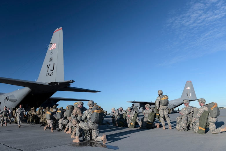 U.S. Soldiers with the 1st Battalion (Airborne), 501st Infantry Regiment, and members of the Japan Ground Self-Defense Force wait to board a C-130 Hercules from Yokota Air Base, Japan, during Red Flag-Alaska at Joint Base Elmendorf-Richardson, Alaska, Aug. 12, 2015. More than 60 U.S. Army Soldiers and more than 20 JGSDF members jumped from multiple C-130 Hercules during the training. More than 20 allied countries have participated in Red Flag-Alaska since its conception, improving integration, interoperability and cross-cultural competence. (U.S. Air Force photo by Staff Sgt. Cody H. Ramirez/Released)