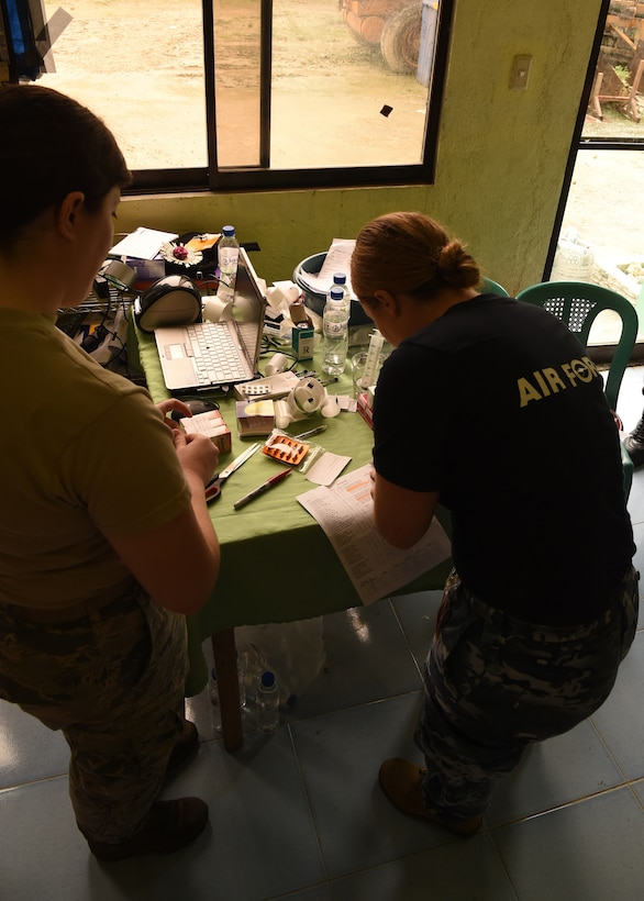 Royal Australian Air Force Flying Officer Kara Sellwood (right), a pharmacist, and U.S. Air Force Staff. Sgt Kristen Williams (left), a pharmacy technician from Andersen Air Force Base, Guam, prepare medication during the Health Services Outreach provided as part of the Pacific Angel Philippines mission taking place in Lila, Bohol province, Philippines, Aug. 16, 2015. Pacific Angel is a multilateral humanitarian assistance civil military operation, which improves military-to-military partnerships in the Pacific while also providing medical health outreach, civic engineering projects and subject matter exchanges among partner forces.(U.S. Air Force photo by Tech. Sgt. Aaron Oelrich/Released)