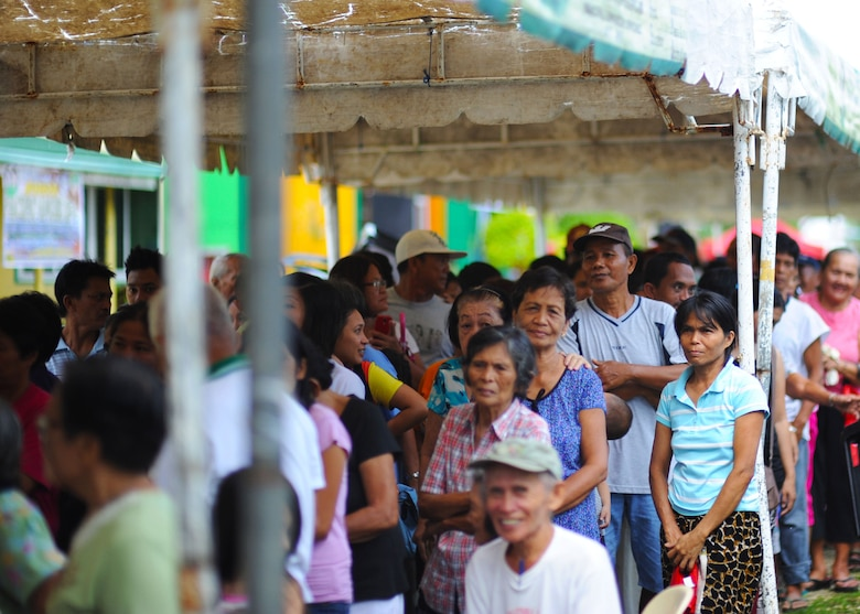 Citizens of Bohol province, Philippines, await their chance to see military doctors, dentists, optometrists, physical therapists and pharmacists from the U.S. Air Force, U.S. Army, U.S. Marine Corps and U.S. Navy along with service members from the Philippines, Australia, Indonesia, Timor-Leste and Papua New Guinea all supporting Pacific Angel Philippines in Lila, Bohol province, Philippines, Aug. 16, 2015. Pacific Angel is a multilateral humanitarian assistance civil military operation, which improves military-to-military partnerships in the Pacific while also providing medical health outreach, civic engineering projects and subject matter exchanges among partner forces. (U.S. Air Force photo by Tech. Sgt. Aaron Oelrich/Released)