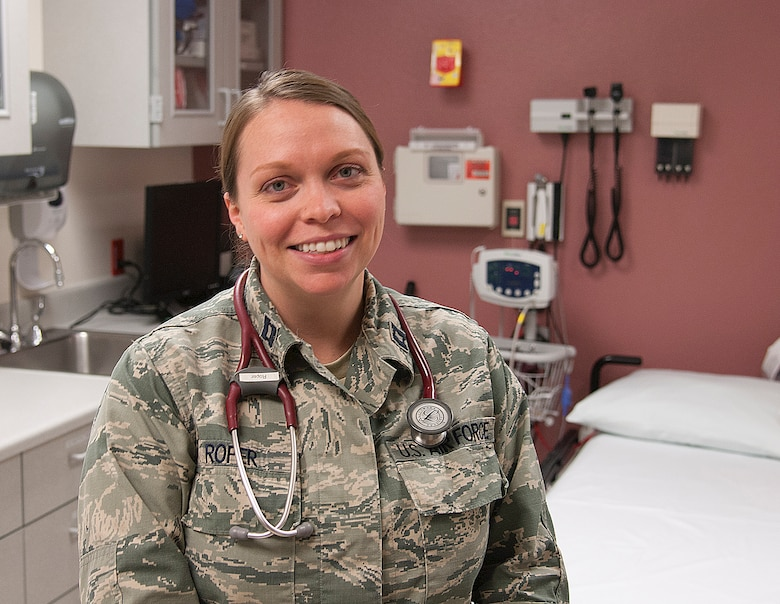 Capt. Jennifer Roper, 90th Medical Operations Squadron family physician, poses in the 90th Medical Group Medical Treatment Facility Aug. 18, 2015, on F.E. Warren Air Force Base, Wyo. Roper offered advice on how to prevent Rhabdomyolysis, the build-up of intracellular material in the blood from damaged muscles, which included staying hydrated and knowing one's limits during exercise. (U.S. Air Force photo by Senior Airman Jason Wiese)
