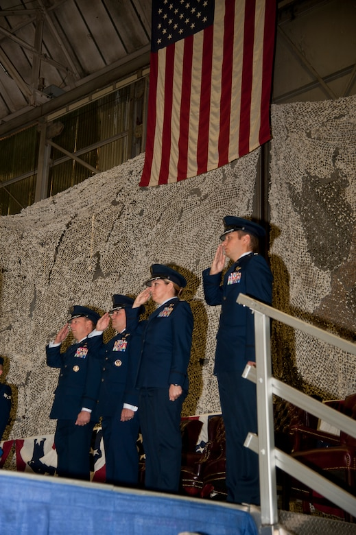 Col. Dagvin Anderson, 58th Special Operations Wing commander, Col. Jonathan Duncan, 336th Training Group commander, Col. Shelley Rodriguez, 58th Operations Group commander and Lt. Col. Jason Snyder, 36th Rescue Squadron commander, salute while the national anthem is played Aug. 14, 2015, at Fairchild Air Force Base, Wash. The commanders were gathered for the 36th RQS re-designation ceremony. (U.S. Air Force photo/Airman 1st Class Taylor Bourgeous)
