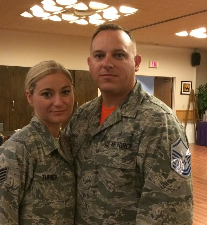 Tech. Sgt. Matthew Turner (right), NCO in charge of the 391st Fighter Squadron medical element, poses with his wife, Staff Sgt. Ann Turner, during the master sergeant promotion social July 17, 2015, at Mountain Home Air Force Base, Idaho. Matthew was selected for promotion to master sergeant two weeks prior to his wife's promotion to technical sergeant. (Courtesy Photo)