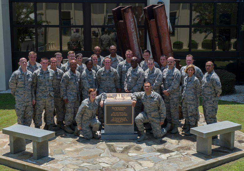 Applicants of the Chaplain Candidacy Program and their cadre pose for a photo in front of the 911 Memorial Aug. 7at the 601st Air Operations Center on Tyndall, AFB. The candidates visited Tyndall as a part of their 35 day intensive internship in which the candidates visit several different military bases to get a sense of the diversity of jobs and lifestyles in the Air Force. (U.S. Air Force photo by Senior Airman Alex Echols/Released)