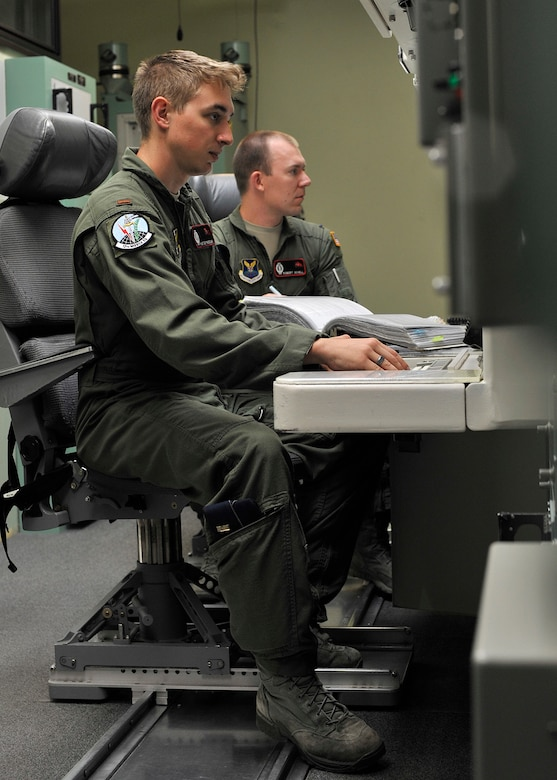 2nd Lt. Hunter Parisian, 12th Missile Squadron deputy crew commander, left, and 1st Lt. Robert Schell, 12th MS crew commander, run a simulated emergency drill in the missile procedures trainer Aug. 8, 2015, during a training session at Malmstrom Air Force Base, Mont., for Global Strike Challenge 2015. The crew is one of three from the 341st Operations Group that will compete Aug. 31 against Minot AFB, N.D., and F.E. Warren AFB, Wyo., in Air Force Global Strike Command's ICBM Operations competition. (U.S. Air Force photo/ John Turner)
