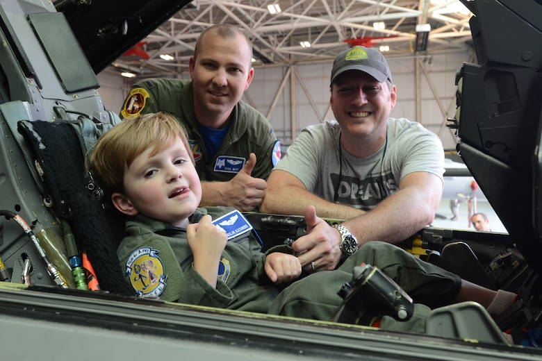 """Declan Alexander sits in an F-16 Fighting Falcon at McEntire Joint National Guard Base, Eastover, S.C., as the Swamp Fox """"Pilot for a Day"""", Aug. 15, 2015. Declan spent the day with U.S. Air Force 1st Lt. Cody """"Rail"""" May, a fighter pilot with the 157th Fighter Squadron, and watched F-16 fighter jets land, toured aircrew flight equipment, sat in the cockpit of an F-16, and took a ride in a fire truck. The Pilot for a Day program is an opportunity for disadvantaged or seriously ill children to spend a day with members of the South Carolina Air National Guard. (S.C. Air National Guard photo by Airman 1st Class Ashleigh Pavelek/Released)"""