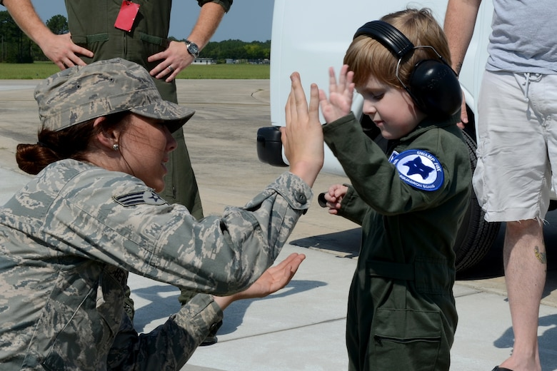 """Declan Alexander visits McEntire Joint National Guard Base, Eastover, S.C., as the Swamp Fox """"Pilot for a Day"""", Aug. 15, 2015. Declan spent the day with U.S. Air Force 1st Lt. Cody """"Rail"""" May, a fighter pilot with the 157th Fighter Squadron, and watched F-16 fighter jets land, toured aircrew flight equipment, sat in the cockpit of an F-16, and took a ride in a fire truck. The Pilot for a Day program is an opportunity for disadvantaged or seriously ill children to spend a day with members of the South Carolina Air National Guard. (S.C. Air National Guard photo by Airman 1st Class Ashleigh Pavelek/Released)"""