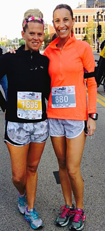 U.S. Air Force 1st Lt. Allison R. Schore, right, a medical administrative officer with the 182nd Medical Group, takes a photo with a friend before running a half-marathon in this undated photo in Peoria, Ill. Schore relied on good foundations in mental, physical, social and spiritual wellness in the aftermath of witnessing a shooting at a restaurant while with her family. (Photo courtesy of Allison Schore/Released)