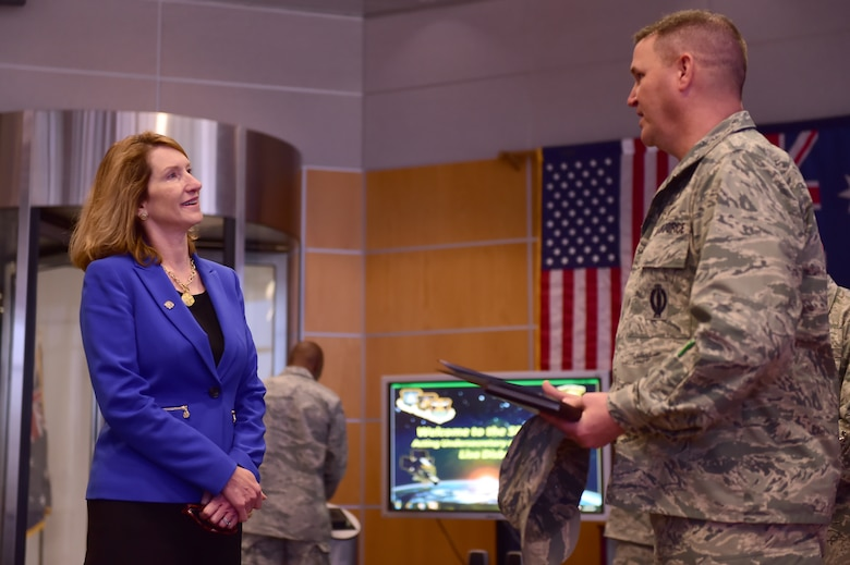 Lisa Disbrow, Action Under Secretary of the Air Force, is briefed on the capabilities of satellites by Col. Michael Jackson, 460th Operations Group commander, Aug. 18, 2015, on Buckley Air Force Base, Colo. (U.S. Air Force photo by Airman 1st Class Luke W. Nowakowski/Released)