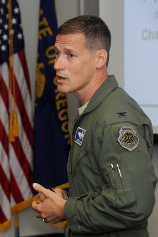 Col. Peter J. Milohnic, Team Chief for the ACC Inspector General, address members of the 142nd Fighter Wing at the start of a Unit Effectiveness Inspection (UEI) Aug. 14, 2015, Portland Air National Guard Base, Ore. (U.S. Air National Guard photo by Tech. Sgt. John Hughel, 142nd Fighter Wing Public Affairs)