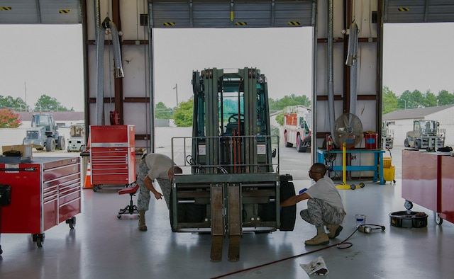 U.S. Air Force Staff Sgt.'s Michael Gustin (left) and Adrian Pitter, 23d Logistics Readiness Squadron material handling equipment and refueling maintenance craftsmen, perform a bearing and break inspection on a forklift Aug. 11, 2015, at Moody Air Force Base, Ga. Over 40 Airmen and civilian contractors in the Vehicle Management Flight help manage 470 vehicles and perform maintenance on 416 Air Force owned vehicles valued at $32.3 million. (U.S. Air Force photo by Airman 1st Class Greg Nash/Released)