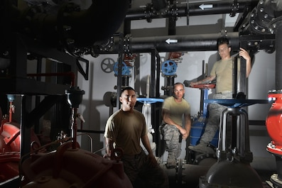Staff Sgt. Daniel Hernandez, Airman 1st Class Steven Blakeley and Staff Sgt. Jon Dones are part of the 379th Expeditionary Civil Engineer Squadron water and fuels flight here at Al Udeid Air Base, Qatar. With the high number of deployed members here at Al Udeid, the 379th ECES water and fuels airmen stay busy day and night keeping the systems running to support the base. (U.S. Air Force photo/ Staff Sgt. Alexandre Montes)