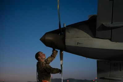 A U.S. Airman assigned to the 62nd Expeditionary Reconnaissance Squadron performs a post flight inspection on a MQ-9 Reaper aircraft at Kandahar Airfield, Afghanistan, Aug. 13, 2015.  The 62nd ERS operates the MQ-1B Predator and Reaper aircraft and provides world-class close air support, intelligence, surveillance and reconnaissance capabilities in Afghanistan. (U.S. Air Force photo by Tech. Sgt. Joseph Swafford/Released)