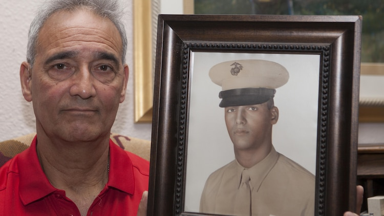 "Benjamin ""Ben"" Palermo holds a photo of himself when he was serving on active duty in the Marine Corps in his home in San Antonio, Texas, June 4, 2015. Palermo served with G Company, 2nd Battalion, 4th Marine Regiment during Operation Starlite during August 1965 in Vietnam."
