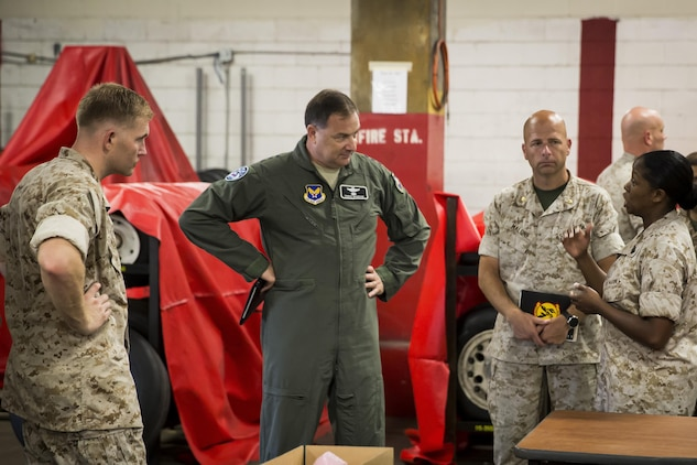 Air Force Lt. Gen. Christopher C. Bogdan, center, speaks to Marines during a tour of the facilities aboard Marine Corps Air Station Beaufort Aug 19. Bogdan visited the air station to inspect all aspects of the F-35 program aboard Fightertown. Bogdan is the Program Executive Officer for the F-35 Lightning II Joint Program Office in Arlington, Va. The Marines are with Marine Aviation Logistics Squadron 31, Marine Aircraft Group 31.