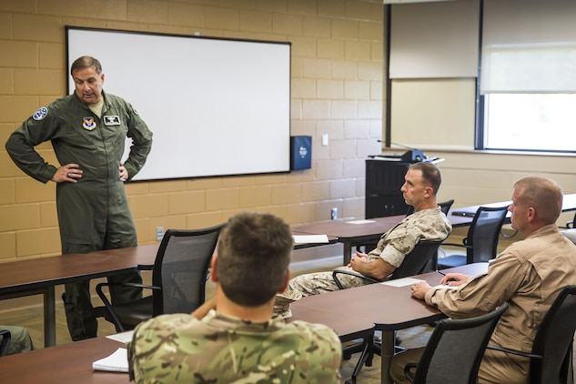 Air Force Lt. Gen. Christopher C. Bogdan, left, speaks to F-35B Lightning II maintainers during a tour of the facilities aboard Marine Corps Air station Beaufort, Aug 19. Bogdan's tour of the air station allowed him to answer questions directly from the Marines who fly and maintain the F-35B. Bogdan is the Program Executive Officer for the F-35 Lightning II Joint Program Office in Arlington, Va. The Marines are with Marine Fighter Attack Training Squadron 501, Marine Aircraft Group 31.
