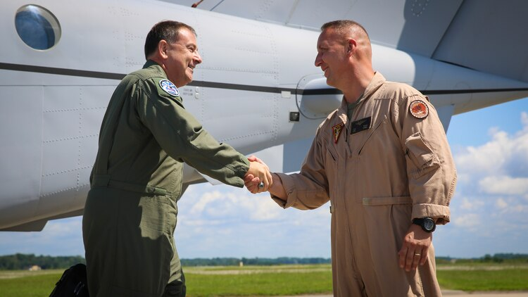 Air Force Lt. Gen. Christopher C. Bogdan, left, is greeted by Col. Peter D. Buck upon his arrival at Marine Corps Air Station Beaufort Aug 19. Bogdan's tour of the air station included stops at Marine Fighter Attack Training Squadron 501 and Marine Aviation Logistics Squadron 31. Bogdan is the Program Executive Officer for the F-35 Lightning II Joint Program Office in Arlington, Va. Buck is the commanding officer of MCAS Beaufort.