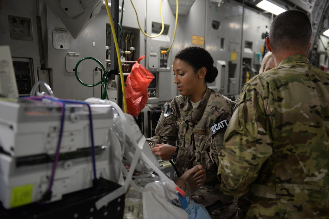 U.S. Air Force Senior Airman Natalie Hives, 455th Expeditionary Aeromedical Evacuation Squadron Critical Care Air Transport Team respiratory therapist deployed from the 60th Medical Group at Travis Air Force Base, California, sets up her equipment and checks on a patient prior to an aeromedical evacuation mission aboard a C-17 Globemaster III aircraft from Bagram Airfield, Afghanistan, to Ramstein Air Base, Germany, Aug. 8, 2015. The 455th EAES' CCATT is a three-person, highly specialized medical team consisting of a physician who specializes in an area of critical care or emergency medicine, a critical care nurse and a respiratory therapist. The CCATT is charged with providing critical care to the sick and wounded as they are moved thousands of miles onboard U.S. cargo aircraft to receive full-time care elsewhere. (U.S. Air Force photo by Maj. Tony Wickman/Released)
