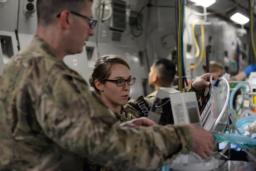 U.S. Air Force Critical Care Air Transport Team members check on a patient prior to an aeromedical evacuation mission aboard a C-17 Globemaster III aircraft from Bagram Airfield, Afghanistan, to Ramstein Air Base, Germany, Aug. 8, 2015. The 455th EAES' CCATT is a three-person, highly specialized medical team consisting of a physician who specializes in an area of critical care or emergency medicine, a critical care nurse and a respiratory therapist. The CCATT is charged with providing critical care to the sick and wounded as they are moved thousands of miles onboard U.S. cargo aircraft to receive full-time care elsewhere. (U.S. Air Force photo by Maj. Tony Wickman/Released)
