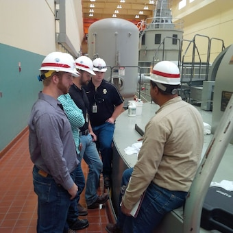 Senior Engineer at Ice Harbor Dam near Walla Walla District explains a generator failure to Hydropower Interns.