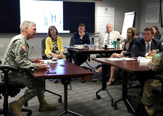 Jerad McIntyre (Right), a civil engineer with the Special Projects Program, Engineering and Support Center, Huntsville, listens with fellow U.S. Army Corps of Engineers emerging leaders as speakerMaj. Gen. Richard Stevens (Left), Deputy Chief of Engineers and Deputy Commanding General, discusses Corps-wide issues during the Executive Governance Meeting in Washington, District of Columbia, Aug. 3-7. McIntyre was named the 2015 Emerging Leader for Huntsville Center in July.
