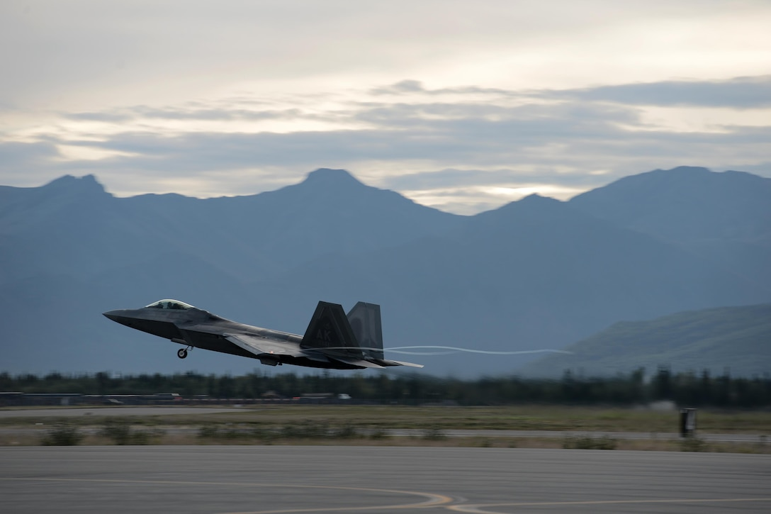 An F-22 Raptor takes off during Red Flag-Alaska at Joint Base Elmendorf-Richardson, Alaska, Aug. 10, 2015. RF-A is an exercise that provides joint offensive counter-air, interdiction, close air support and large force employment training in a simulated combat environment. More than 20 allied countries have participated in RF-A since its conception, improving integration, interoperability and cross-cultural competence. (U.S. Air Force photo/Staff Sgt. Cody H. Ramirez)