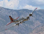 """The Experimental Aircraft Association's B-17, also known as """"Aluminum Overcast,""""  banks right above Hill Air Force Base, Utah, Aug. 13, 2015.  EAA's B-17 is painted to resemble B-17G No. 42-102515 of the 398th Bombardment Group (Heavy) that flew from Royal Air Force Nuthampstead, England, during World War II. That aircraft was shot down over Le Manior, France, on Aug. 13, 1944, during its 34th combat mission. (U.S. Air Force photo/R. Nial Bradshaw)"""