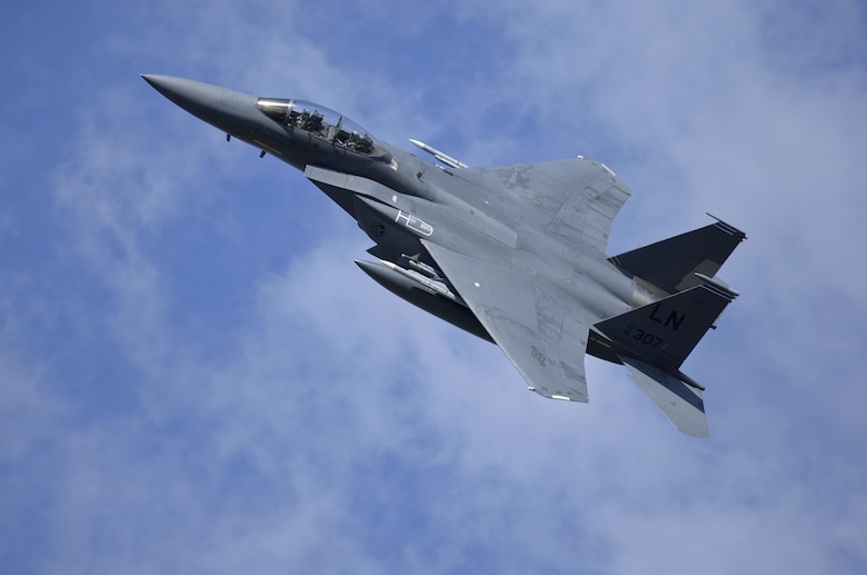 An F-15E Strike Eagle assigned to the 48th Fighter Wing flies over Royal Air Force Lakenheath, England, during a training sortie Aug. 17, 2015. The 48th FW is responsible for providing air combat superiority for the U.S. Air Forces in Europe and Air Forces Africa area of responsibility. (U.S. Air Force photo/Senior Airman Trevor T. McBride)