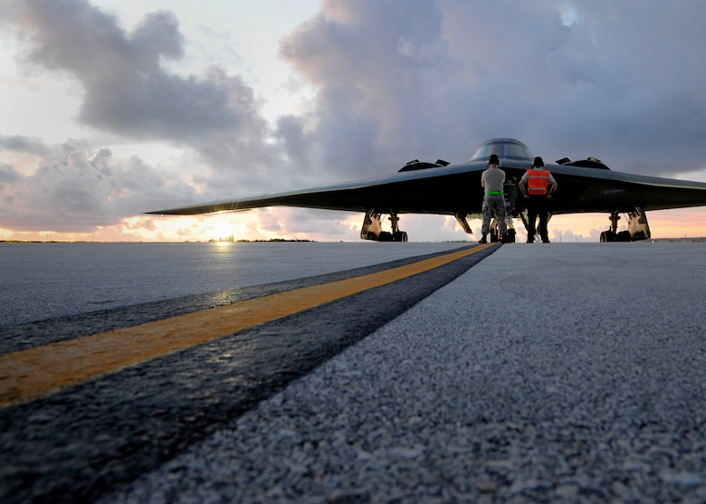 Crew chiefs assigned to the 509th Aircraft Maintenance Squadron prepare to launch a B-2 Spirit at Andersen Air Force Base, Guam, Aug. 12, 2015.  Three B-2s and about 225 Airmen from Whiteman AFB, Missouri, deployed to Guam to conduct familiarization training activities in the Indo-Asia-Pacific region. (U.S. Air Force photo/Senior Airman Joseph A. Pagán Jr.)