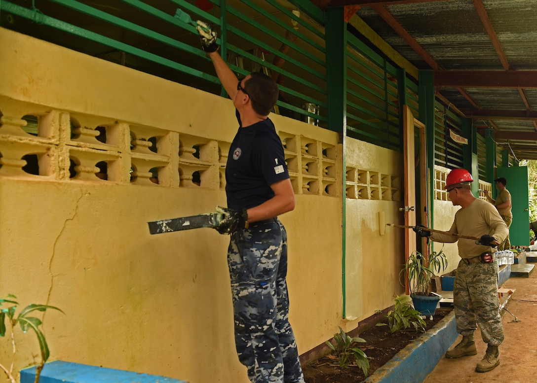 Engineering civic action project team members paint Owac Elementary school during Pacific Angel Philippines, Bohol Provence, Philippines, Aug. 19, 2015. Owac Elementary is one of six schools repaired by the U.S. Air Force, U.S. Army and U.S. Marine Corps along with service members from the Philippines and Australia. Efforts undertaken during Pacific Angel help multilateral militaries in the Pacific improve and build relationships across a wide spectrum of civic operations, which bolsters each nation's capacity to respond and support future humanitarian assistance and disaster relief operations. (U.S. Air Force photo by Tech. Sgt. Aaron Oelrich/Released)