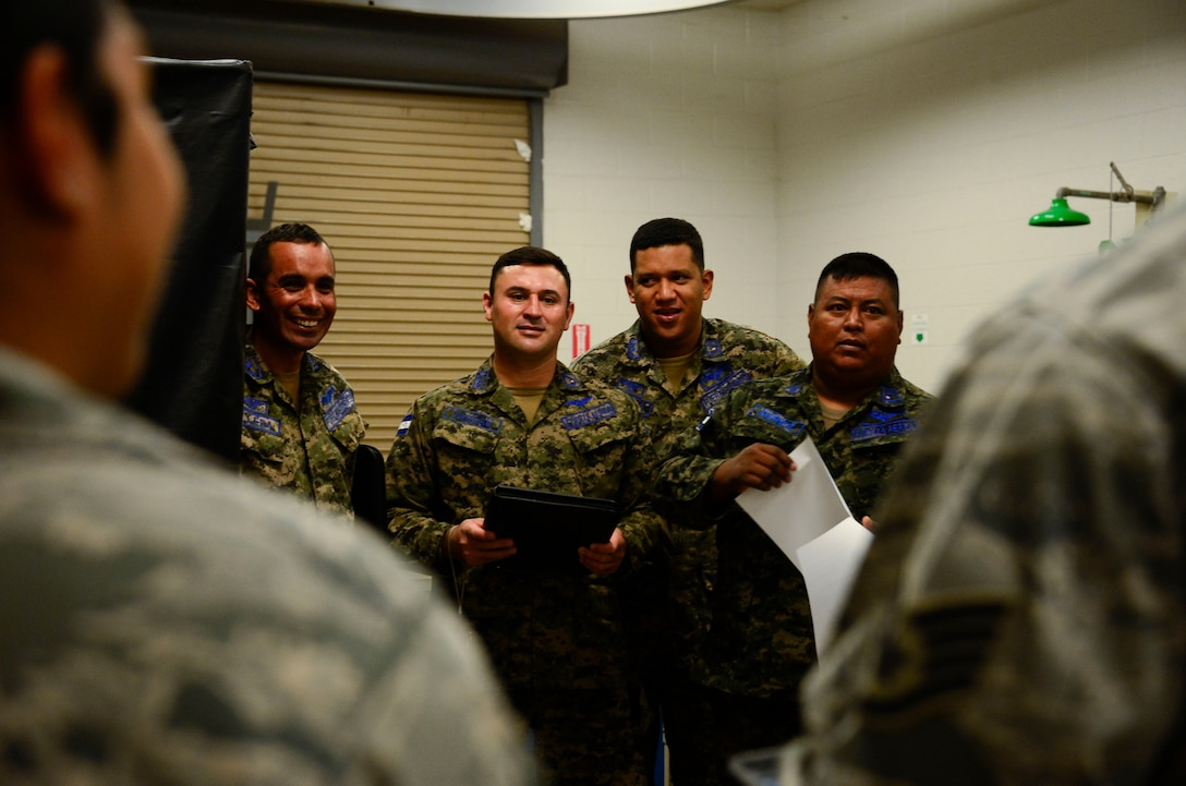 Members of the Honduran air force meet with the Airmen at the 355th Equipment Maintenance Squadron nondestructive inspections lab during a subject matter expert exchange event on Davis-Monthan AFB, Ariz., Aug. 19, 2015. Five members from the Honduran air force teamed up with 12th Air Force (Air Forces Southern) and the 355th EMS for a subject matter expert exchange that focused on a variety of nondestructive inspections lab processes and maintenance safety standards. (U.S. Air Force photo by Tech. Sgt. Heather Redman/Released)