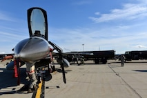 A U.S. Air Force crew chief performs regular checks on an F-16 Fighting Falcon assigned to the Minnesota Air National Guard's 148th Fighter Wing out of Duluth, Minn., on the Eielson Air Force Base, Alaska, flightline Aug. 14, 2015, as 354th Logistics Readiness Squadron Airmen refuel the aircraft in preparation for its next RED FLAG-Alaska (RF-A) 15-3 sortie. RF-A is a Pacific Air Forces commander-directed field training exercise for U.S. and partner nation forces, providing combined offensive, counter-air, interdiction, close-air support, and large-force employment training in a simulated combat environment. (U.S. Air Force photo by Airman 1st Class Kyle Johnson)