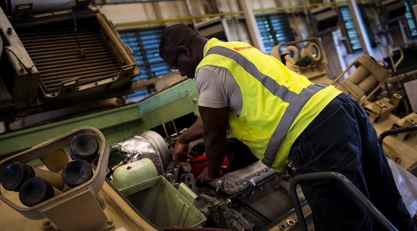 Anthony Moore, a mechanic with the Army Strategic Logistics Activity – Charleston, does maintenance on a M113 Armored Personnel Carrier Aug. 20, 2015 at Joint Base Charleston, S.C. ASLAC provides the U.S. warfighter the ability to quickly generate combat power at any location designated by the National Command Authority by establishing, maintaining and reconstituting Army Prepositioned Stocks Afloat. (U.S. Air Force photo/Airman 1st Class Clayton Cupit)