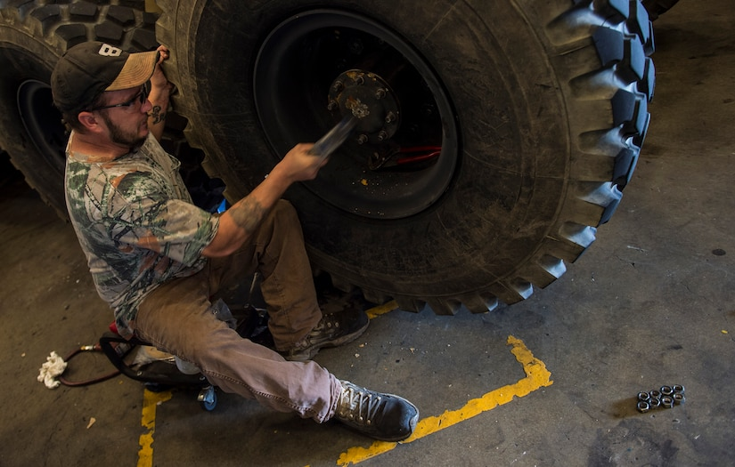 Robert Kolby, a mechanic with the Army Strategic Logistics Activity – Charleston, does maintenance on a M1120 Heavy Expanded Mobility Tactical Truck Load Handling System Aug. 20, 2015 at Joint Base Charleston, S.C. ASLAC provides the U.S. warfighter the ability to quickly generate combat power at any location designated by the National Command Authority by establishing, maintaining and reconstituting Army Prepositioned Stocks Afloat. (U.S. Air Force photo/Airman 1st Class Clayton Cupit)